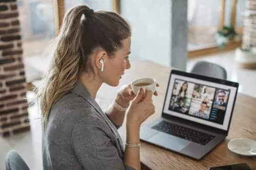 Women watching a webinar in her home