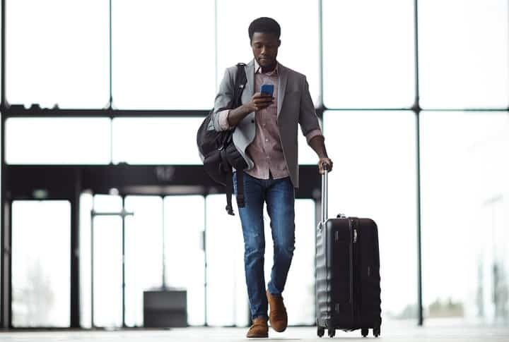 Mobile Wealth Management: Young mobile traveler with smartphone